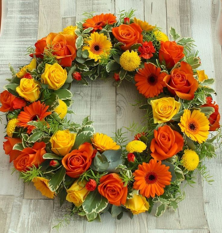 Funeral Flowers Orange Wreath From £45